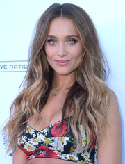 Hannah Jeter glammed up her look with this long wavy hairstyle for the SI Summer of Swim Fan Festival.