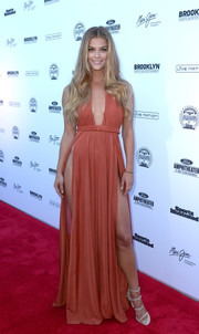 Nina Agdal sent temperatures rising with this rust-colored, slashed-to-the-hip Grecian gown during the SI Summer of Swim Fan Festival.