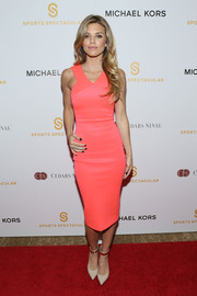 Nude pumps with metal-embellished ankle cuffs completed AnnaLynne McCord's red carpet look.