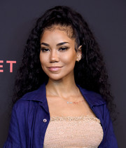 Jhene Aiko wore her hair in a half-up curly style at the Secret Genius Awards.