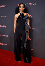 Kelly Rowland looked fabulous in a strapless black Azzi & Osta jumpsuit with dramatic ruffle detailing at the Secret Genius Awards.