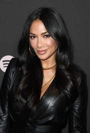 Nicole Scherzinger wore her hair down with a center part and soft waves at the Spotify Best New Artist 2019 event.