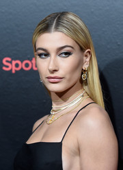 Hailey Baldwin dolled up her lobes with a pair of crystal-accented gold-tone earrings by Versace.