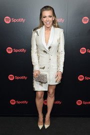 Rachel Platten was modern and edgy in an embellished white tux dress with an asymmetrical hem during Spotify's Best New Artist party.