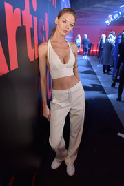 Martha Hunt matched her top with a pair of slouchy white slacks.