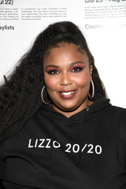 Lizzo wore her hair in a high ponytail at the Spotify Cosmic Playlist launch.