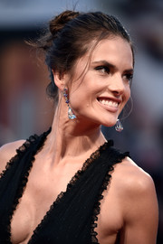 Alessandra Ambrosio styled her edgy updo with a dazzling pair of crystal drop earrings.