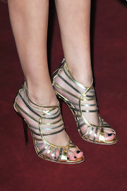 Selena Gomez rocked fun silver and gold strappy sandals at the 'Spring Breakers' premiere.