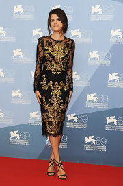 Selena Gomez completed her gorgeous black lace and gold brocade look with simple and striking black strappy stilettos.