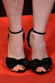 Rachel Korine's heels had a little girlie flair with a lace ruched bow at the toe.