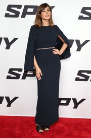 Nargis Fakhri looked very classy at the 'Spy' New York premiere in a midnight-blue Samuel Dougal column dress featuring a split cape to reveal her bare back.