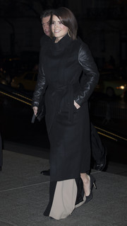 Princess Eugenie bundled up in edgy style with a black funnel-neck coat with leather sleeves.