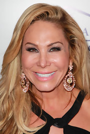 Adrienne Maloof went all out with her accessories at the Southern Style event, wearing a pair of intricate gold dangling earrings.