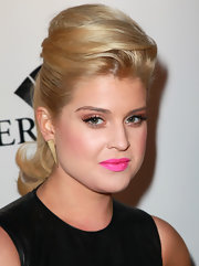 Kelly Osbourne paired her voluminous ponytail with gold spiked earrings.