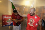 Albert Pujols wore a sleeveless red T-shirt to celebrate victory over the Philadelphia Phillies in the locker room.
