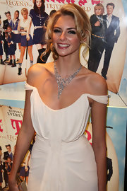 Tamsin Egerton accentuated her décolletage with a layered diamond necklace at a movie premiere.
