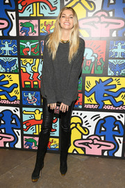 Jessica Hart was casual and cozy in a gray crewneck sweater and black leather pants at the launch of Keith Haring x Alice + Olivia.