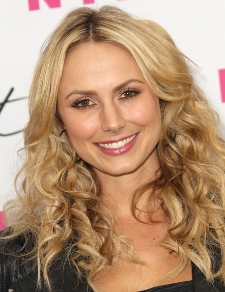 Stacy Keibler parted her long ringlet curls down the center for the ...