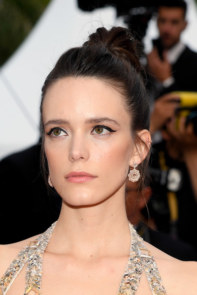 Stacy Martin Classic Bun [hair,eyebrow,hairstyle,face,lip,fashion model,beauty,chin,fashion,shoulder,sibyl,stacy martin,sibyl red carpet,screening,cannes,france,the 72nd annual cannes film festival]