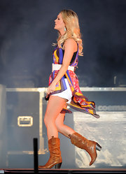 Carrie Underwood took to the stage at the Stagecoach Country Music Festival in cognac leather cowboy boots. Carrie's choice in footwear added the perfect classic country touch to her style.