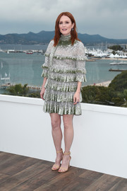 Julianne Moore shone in a tiered, sequined cocktail dress by Valentino at the 2019 Cannes Film Festival photocall for 'The Staggering Girl.'