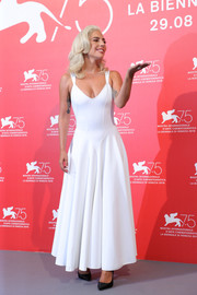 Lady Gaga looked simply chic in a white maxi dress by Azzedine Alaïa at the Venice Film Festival photocall for 'A Star is Born.'