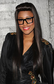 Singer VV Brown rocked an interesting hairstyle to the Young Hollywood party. She sported a long straight cut with her bangs rolled up in a hair roller.