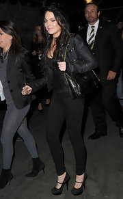 Lindsay carried a black exotic skin shoulder bag with gold hardware and a flap closure.