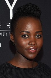 Lupita Nyong'o rocked metallic cateye shadow and liner for a galactic-inspired look.