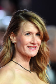 Laura Dern went for a stylish feathery 'do when she attended the European premiere of 'Star Wars: The Last Jedi.'