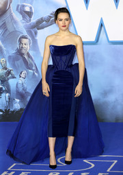 Daisy Ridley glammed up in a strapless cobalt corset dress with a voluminous overskirt for the European premiere of 'Star Wars: The Rise of Skywalker.'