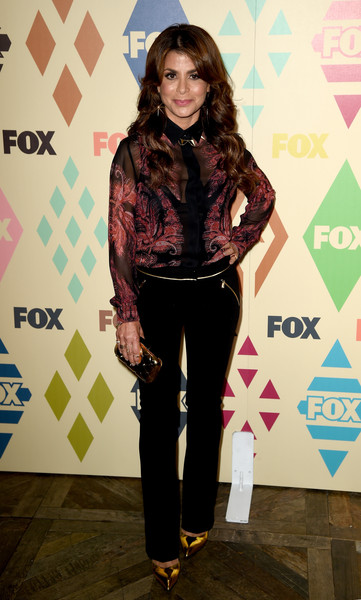 Paula Abdul opted for a pair of gold-trimmed slacks to finish off her outfit.