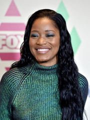 Keke Palmer was in the mood for jewel tones, pairing blue eyeshadow with her metallic-green outfit.