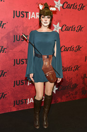 Ashley Greene completed her costume with brown knee-high boots.