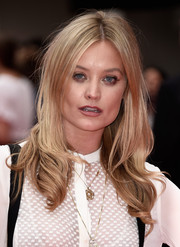 Laura Whitmore adorned her white outfit with a gold pendant.
