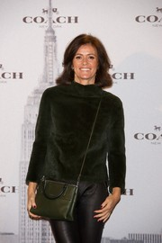 Nuria March accessorized with a stylish olive-green cross-body tote during the Coach boutique opening in Madrid.