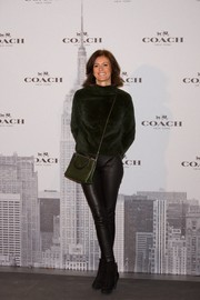 Nuria March donned a luxe black fur turtleneck for the Coach boutique opening in Madrid.