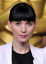 Rooney Mara wore a sheer hot pink lipstick with a pat of clear gloss at the 84th Academy Awards nominations lunch.