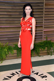 Liberty Ross wowed in a bondage-chic red cutout dress during the Vanity Fair Oscar party.