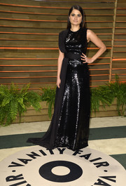 Melonie Diaz shone in an elegant black sequined gown during the Vanity Fair Oscar party.