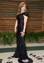 Isla Fisher chose a black one-shoulder gown by Zac Posen for the Vanity Fair Oscar party.
