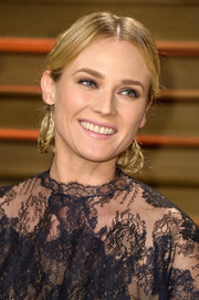 Diane Kruger fixed her hair into a charming chignon made up of multiple braids for the Vanity Fair Oscar party.