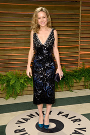 Brie Larson teamed her dress with a chic pair of blue round-toe satin pumps by Prada.