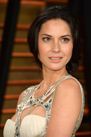 There's something so sexy and romantic about an updo that looks like it's about to come undone, like the one Olivia Munn wore to the Vanity Fair Oscar party.