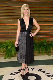 Reese Witherspoon paired her chic dress with black Christian Louboutin ankle-strap sandals.