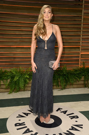 Gigi Hadid flashed some cleavage in a low-cut gray lace dress during the Vanity Fair Oscar party.