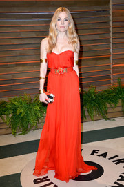 Sienna Miller complemented her red-hot dress with a tricolor beaded clutch, also by Alexander McQueen.