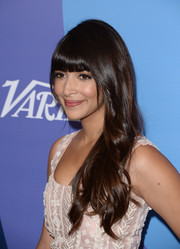 Hannah Simone styled her locks in a sweet wavy 'do with blunt bangs for the Variety Power of Women event.
