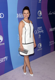 Katie Lowes looked mod in a sleeveless white shift dress with black piping at the Variety Power of Women event.
