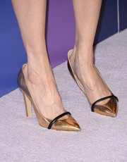 A pair of gold pointy pumps with black accents added shimmer to Darby Stanchfield's look during the Variety Power of Women event.